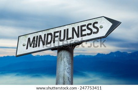 Mindfulness sign with sky background - stock photo
