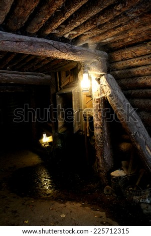 Mine - dungeon - tunnel with vintage lamp and miner tools - stock photo