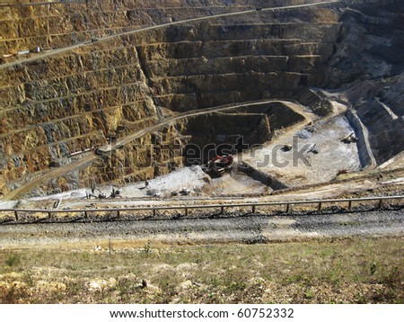 Mine gold and silver with machinery working at the base - stock photo