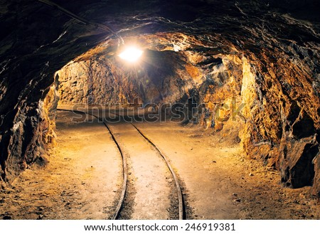Mine gold underground tunnel railroad - stock photo