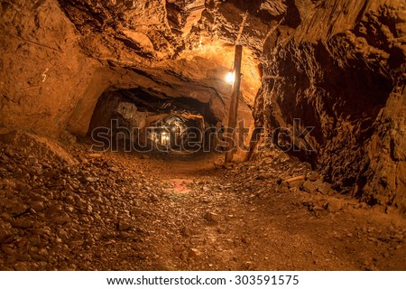 Mine Shaft. Interior of a mining shaft with diminishing perspective and copy space. - stock photo