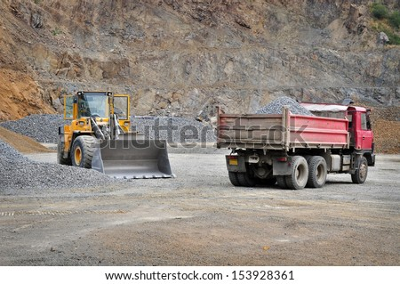 Mine site with machines, quarry - stock photo