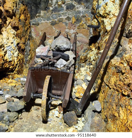 Mine symbol - hammer and wheelbarrow - stock photo