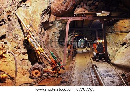 Mine tunnel with railway - stock photo