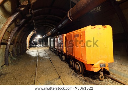 Mine with wagons - stock photo