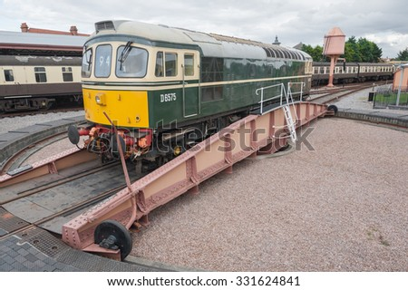 MINEHEAD, UK - 13 SEPTEMBER: Restored vintage diesel locomotive, circa 1960 on the train turntable at The West Somerset Railway in Minehead, UK on 13 September, 2015 - stock photo