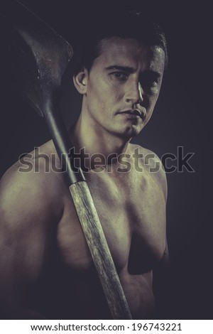 Miner .Male worker holding a shovel, sexy builder - stock photo
