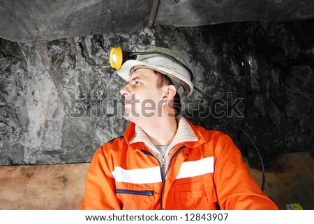 Miner profile in a mine shaft stock photo
