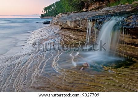 Miner's Beach cascade at twilight, Lake Superior, Pictured Rocks National Lakeshore, Michigan's Upper Peninsula, USA - stock photo