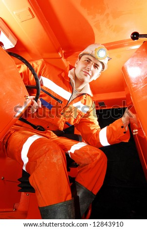 Miner working in a mine shaft stock photo