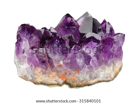 Mineral amethyst crystals on a white background - stock photo