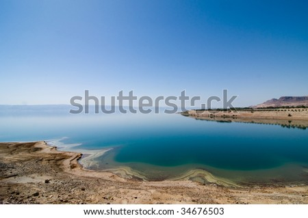 Mineral deposits ring the eastern shore of the Dead Sea in Jordan.