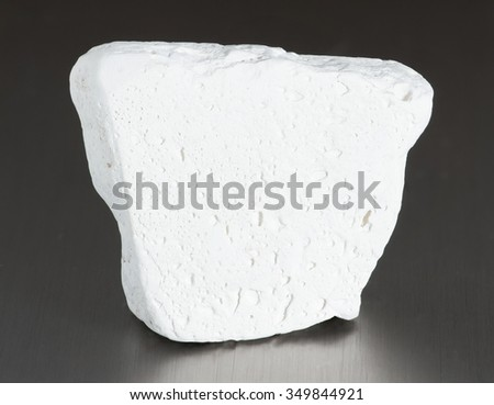 Mineral kaolinite (kaolin). The main use of the mineral kaolinite is the production of paper; its use ensures the gloss on some grades of coated paper. - stock photo
