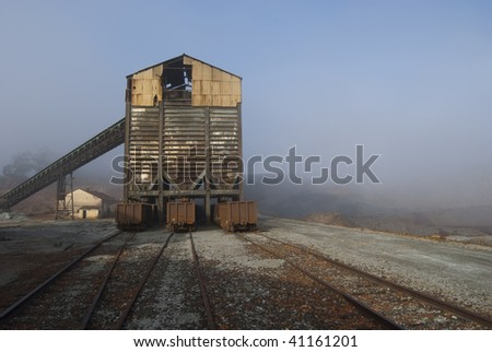 mineral loading conveyor and freight cars