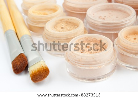 mineral make-up in containers, powder, blush, eye shadows, brushes - stock photo