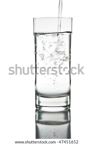 mineral water being poured into a glass - stock photo