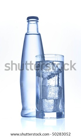 mineral water bottle and glass - stock photo