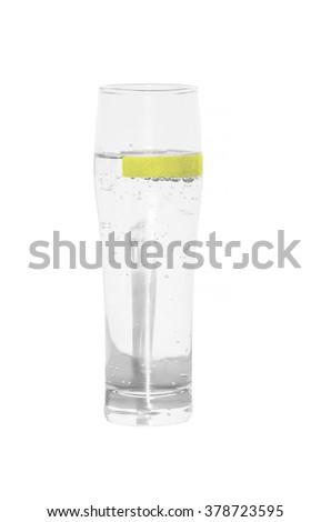Mineral water glass isolated with lemon slice. - stock photo