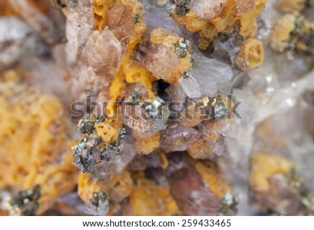 Mineral, yellow calcite and pyrite close up - stock photo