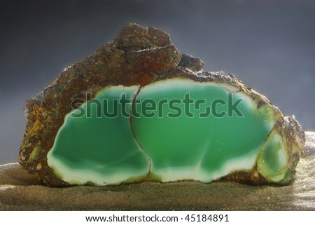 Mineralogical specimen of chysoprase shooted under the water - stock photo