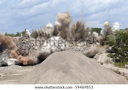 Miners set an explosion at the open pit quarry. - stock photo