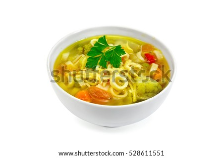 Minestrone soup with meat, celery, tomatoes, zucchini and cabbage, green peas, carrots and pasta in a bowl isolated on white background