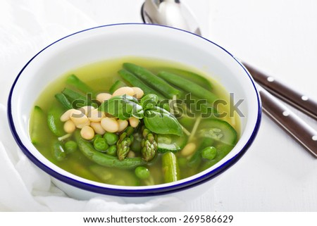 Minestrone soup with spring green vegetables and white beans - stock photo