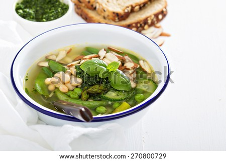 Minestrone soup with spring green vegetables and white beans
