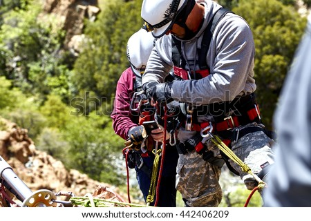 Mingus Mountain, Arizona, USA - May 6, 2016: Jerome, Arizona firefighters working together with Exxon Rescue Squad practicing a rescue drill in Mingus Mountain on the side of the cliff - stock photo