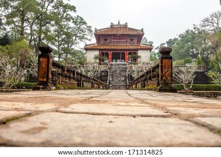 Minh Lau pavilion and Trung Dao bridge at Ming Mang Emperor Tomb in Hue, Vietnam - stock photo