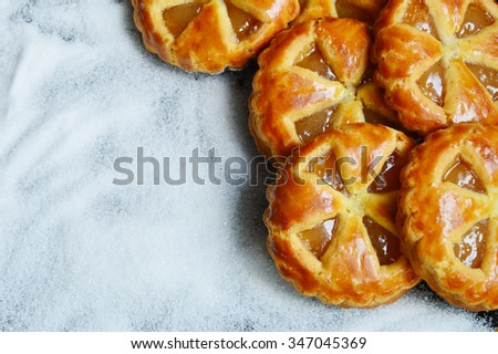 Mini apple pies with sugar background - stock photo