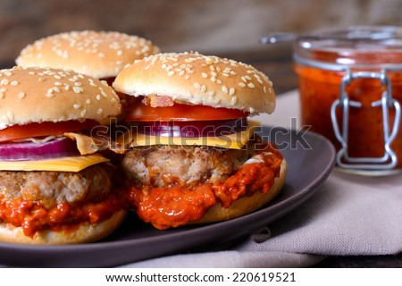 Mini beef burgers stuffed with ajvar salad,selective focus  - stock photo