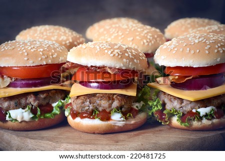 Mini beef burgers with vegetables and cheese,selective focus - stock photo