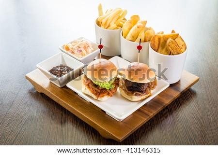 mini burger sliders beef pork vegetarian grilled roasted bun sauce dip fries potatoes chips selection  - stock photo