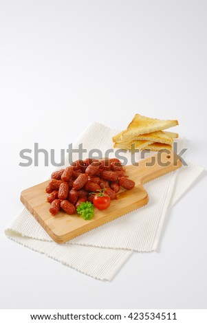 mini cabanossi sausages with toasted white bread