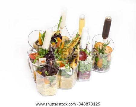 mini canape with meat and vegetables on a white background seafood
