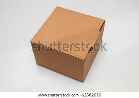 Mini cardboard box isolated - stock photo