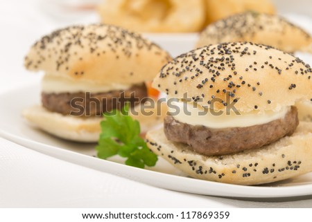 Mini Cheeseburgers - Bite size cheeseburgers with Aberdeen Angus patties and poppy seed topped buns. - stock photo