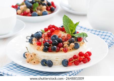 mini cheesecake with fresh berries on a plate, horizontal - stock photo
