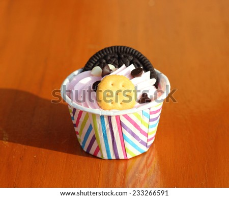 Mini cupcake with biscuit on top  - stock photo