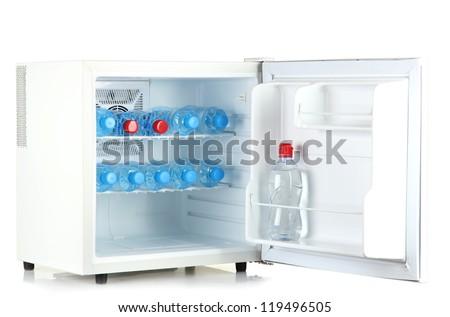 mini fridge full of bottled water isolated on white - stock photo