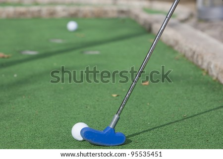 Mini Golf ball on a green background - stock photo
