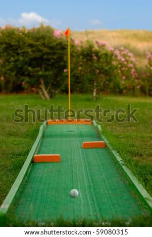 Mini golf ready to play. Outdoors scene - stock photo