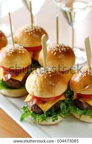 mini hamburgers, mini burgers, party food, finger food - stock photo