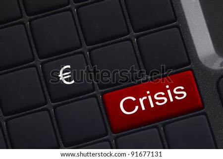 mini keyboard with selective focus on the enter button saying Crisis and  symbol EURO