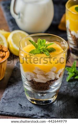 Mini Lemon Curd Cheesecakes, delicious lemon flavour and crispy biscuit - stock photo