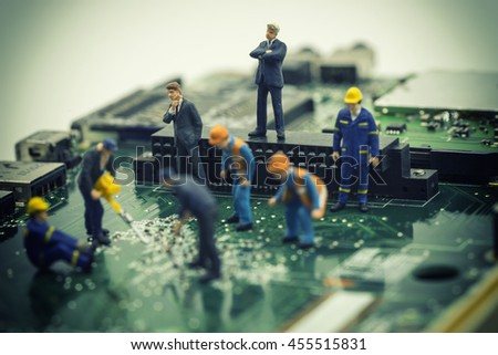 mini management team control worker repair mainboard on vintage filter - can use to display or montage on products - stock photo