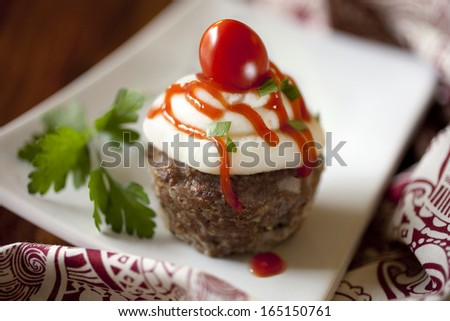 Mini Meatloaf Cupcakes with Mashed Potato Frosting - stock photo