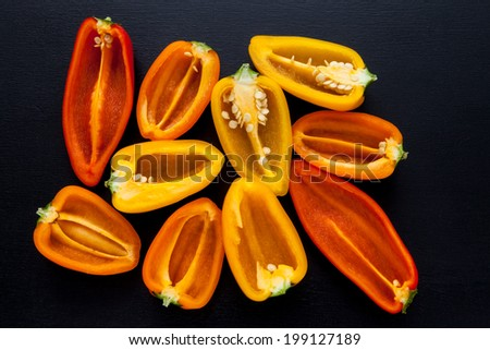 Mini paprika on a black background - stock photo