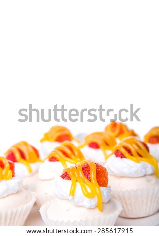 Mini pavlova with strawberry topping in white plate over white background